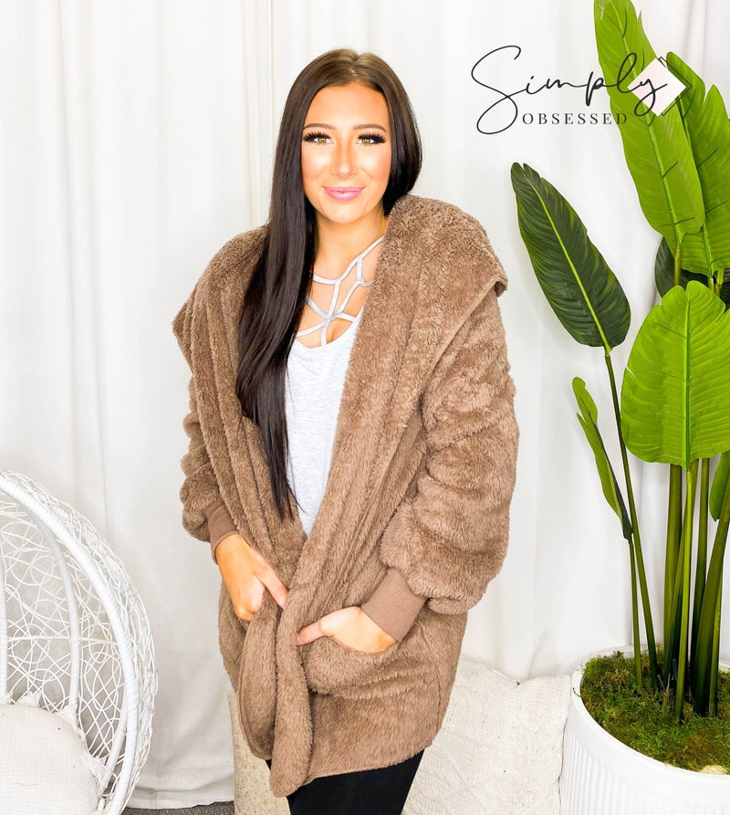 Hooded faux fur jacket with pockets