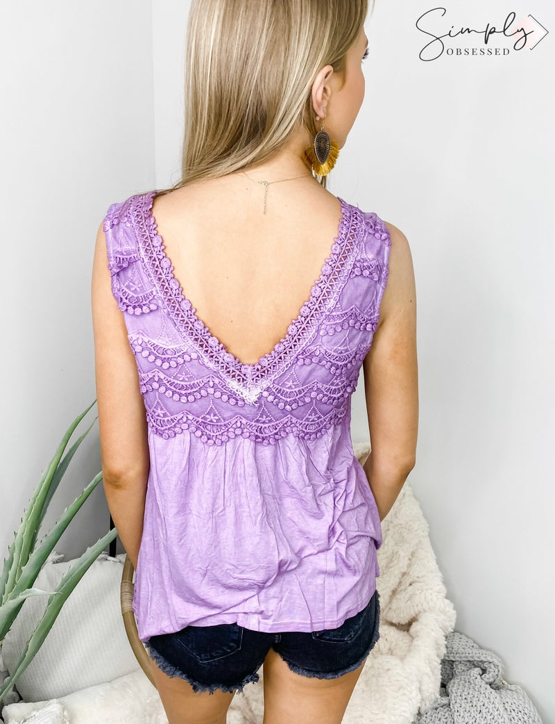 Sleeveless top with lace trim and v-neck detail