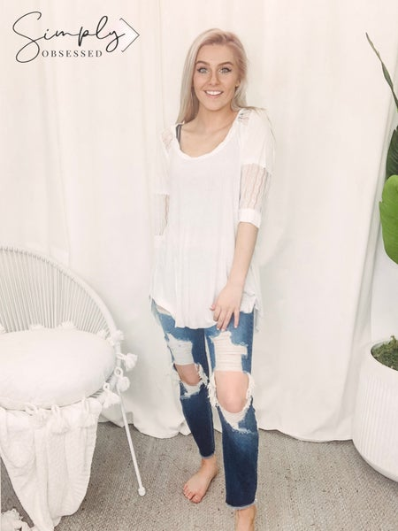 Deep v neck oversized shirt with raw edged neck band and sleeve band featuring stripe knitted inset