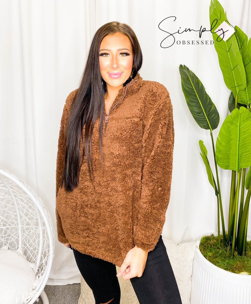 Solid soft sherpa pull over sweater with zip up detail