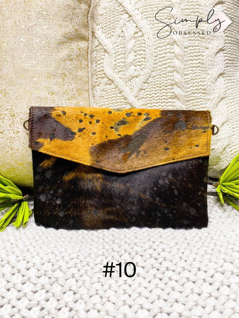 Cross body envelop handbag