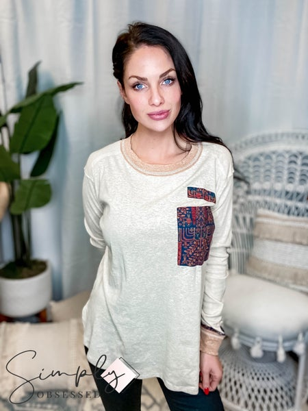 Easel - Long sleeve round neck top with pocket design and cuff detail