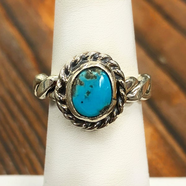 silver braided band with turquoise stone