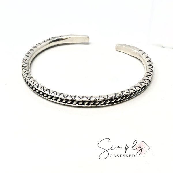 Unique adjustable breaded silver cuff