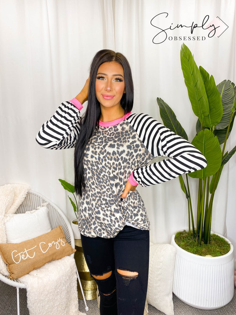 VANILLA BAY-A leopard print knit top featuring twist hem detail with stripe long sleeve and neon band details