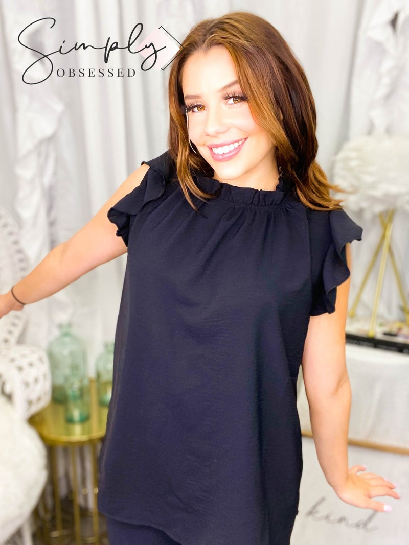 Bibi - Sleeveless woven top with ruffle detail