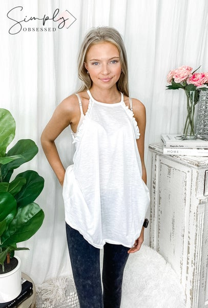 White Birch - Sleeveless solid knit top with a high neck featuring a ruffle detail with back keyhole