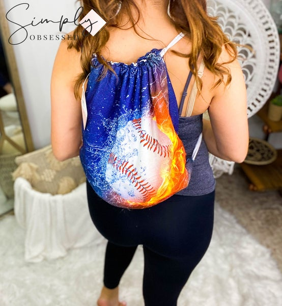 Beach towel that folds into drawstring detail back pack