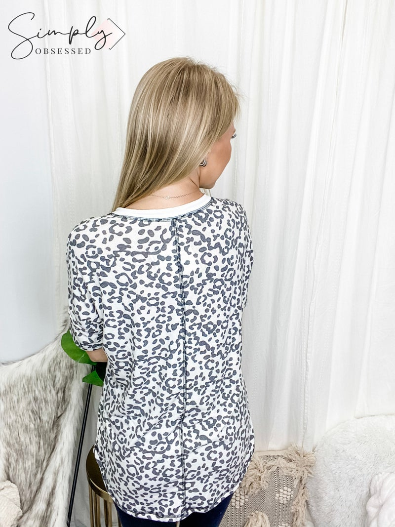 White Birch - Short sleeve cheetah print knit top with v neck
