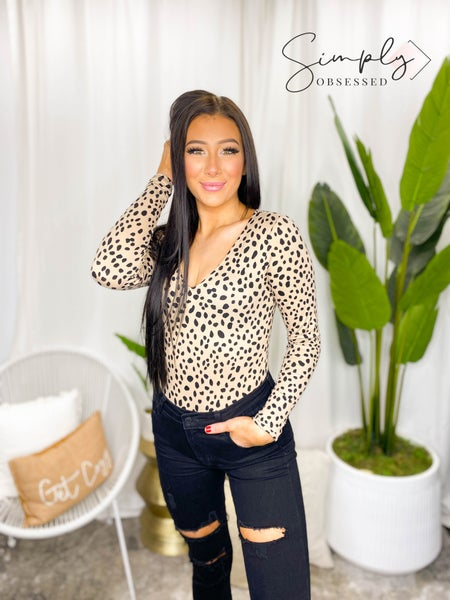 VANILLA BAY-A leopard print knit bodysuit top featuring long sleeve and v-neck with snap button closer
