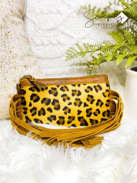 Small cheetah print cross body bag