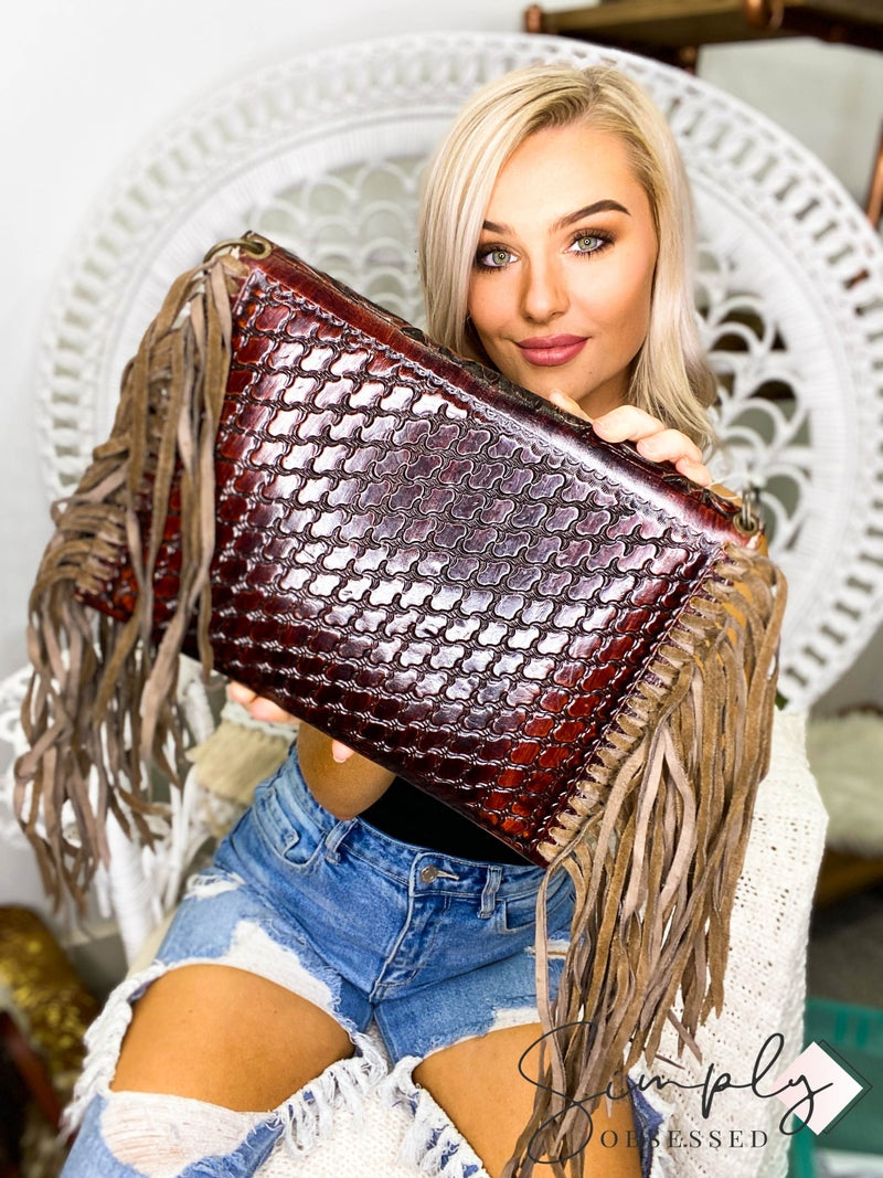 American Darling - Hand crafted leather work tassel detail envelop bag