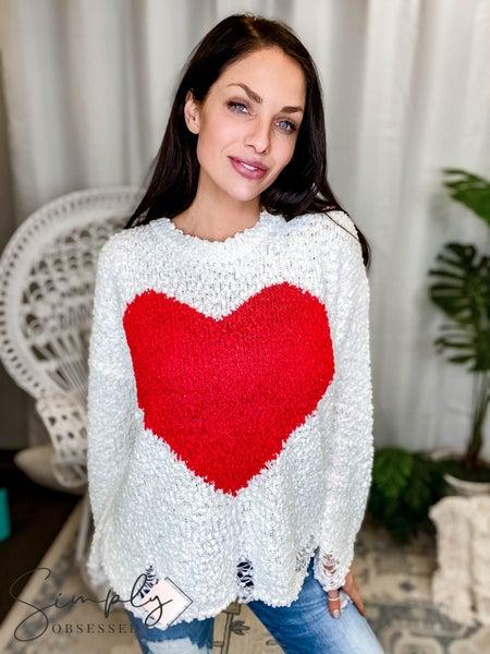 Main Strip - Round neck distressed heart sweater