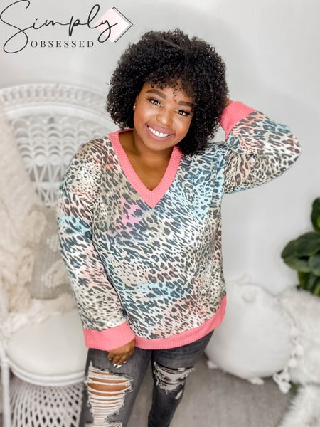 WHITE BIRCH-A long sleeve multi animal print knit top with a v-neck with a kimono sleeve and a solid waffle knit trim