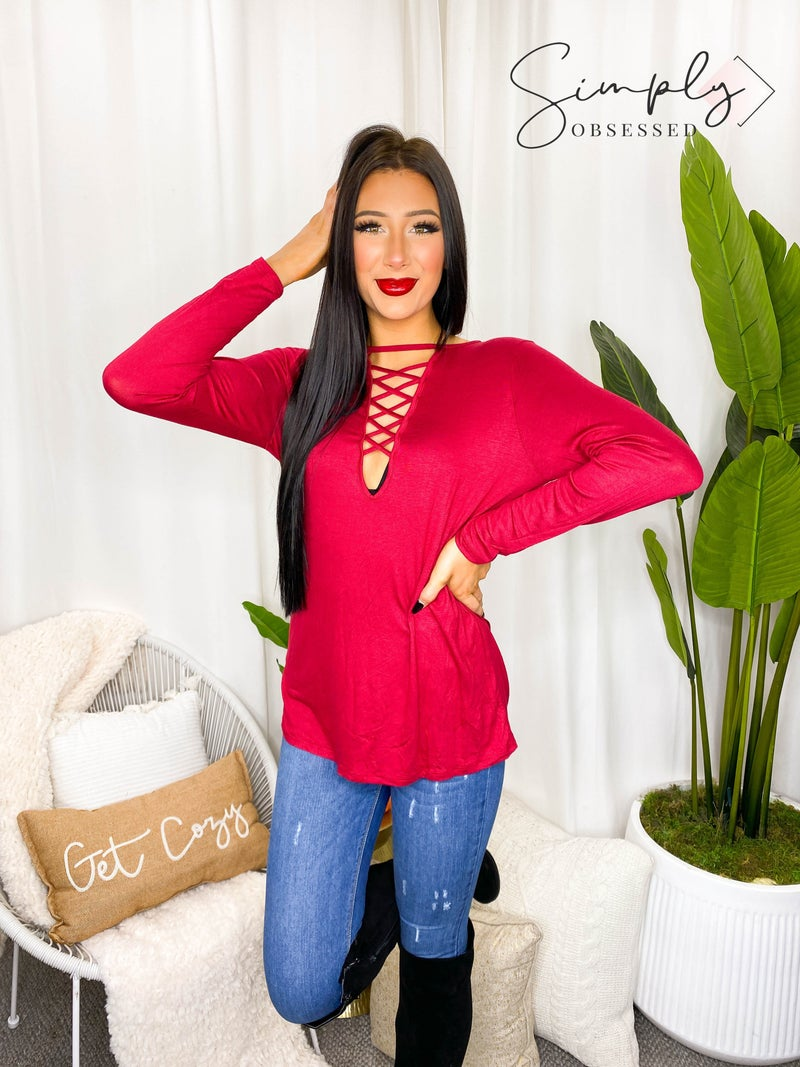 BiBi - Long sleeve jersey knit top with criss cross caged neck detail