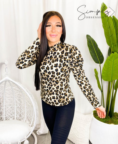 Main Strip - Mock neck pleats long sleeve leopard print knit top
