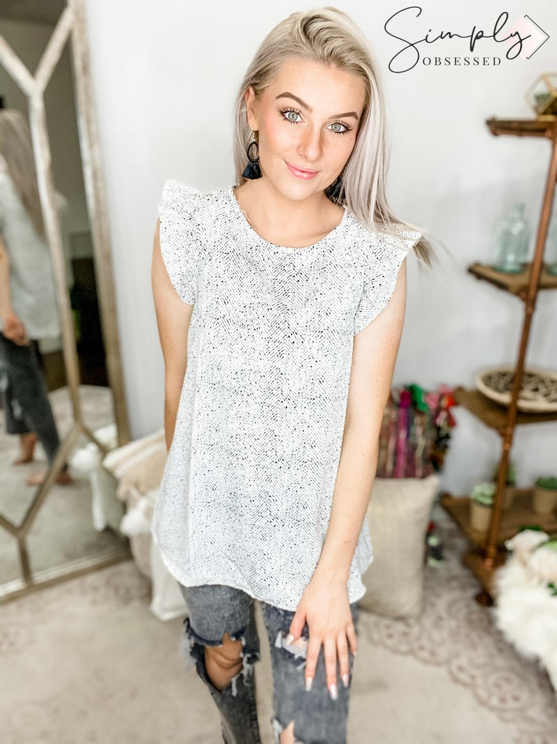ANDREE-B&W Speckled Tank With Ruffle Shoulders