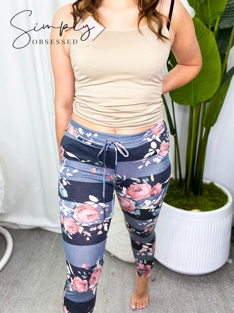 HEIMISH-STRIPPED JOGGER PANTS WITH FLORAL PATTERN AND SIDE POCKETS