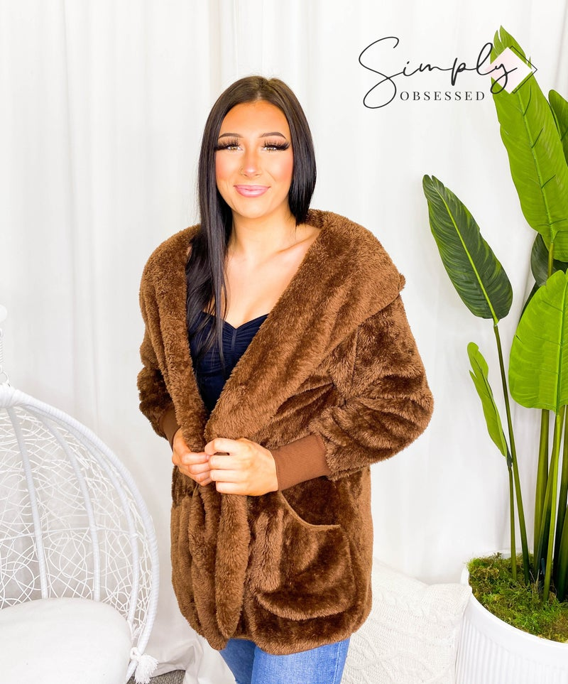 Long sleeve hooded faux fur cocoon jacket with pockets