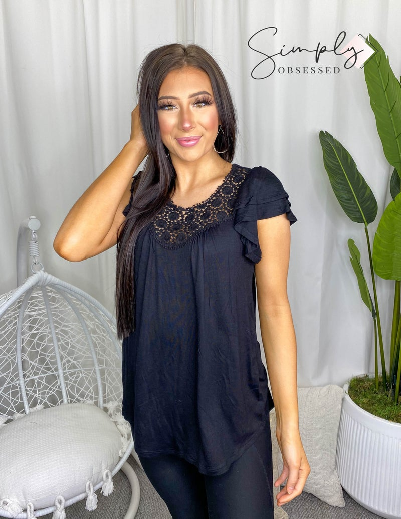 Simple top with double layered ruffle sleeves and lace trim for the neck line