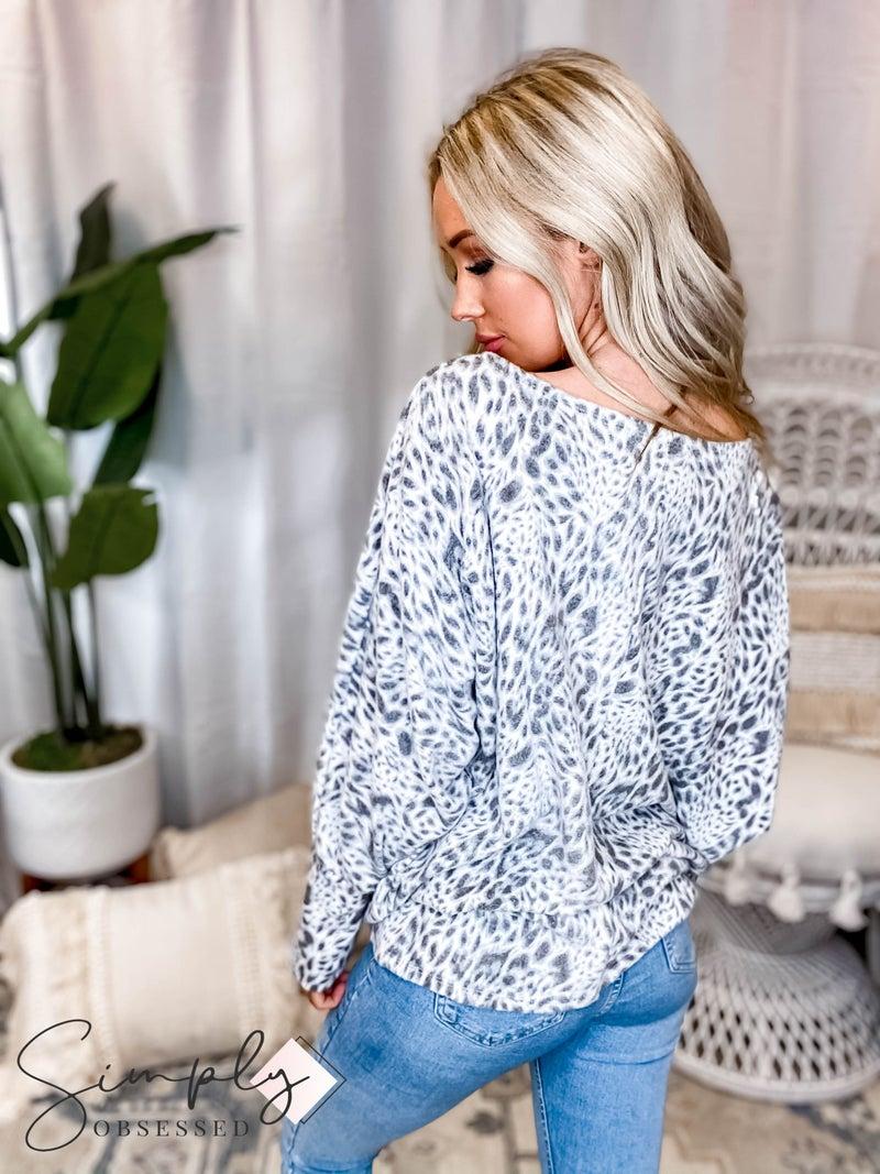 Fantastic Fawn - Long sleeve bold animal print knit batwing top