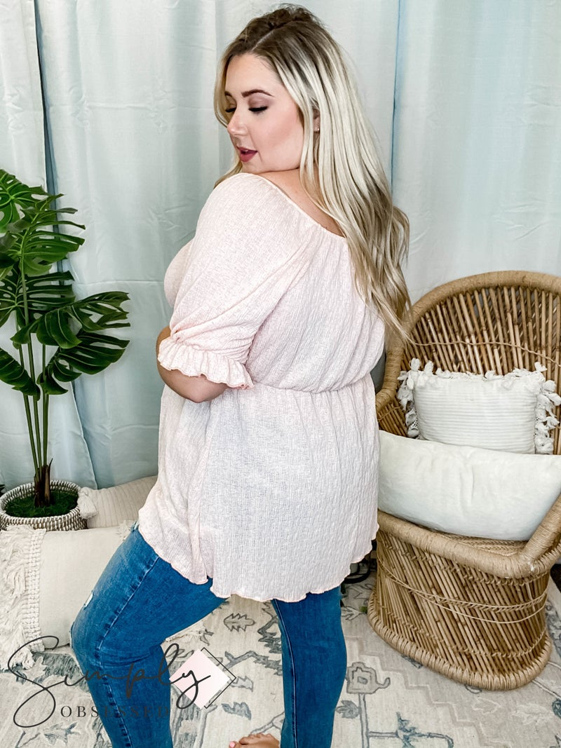 White Birch - A short sleeve solid knit top with square neck featuring a puff sleeve and elastic waistband