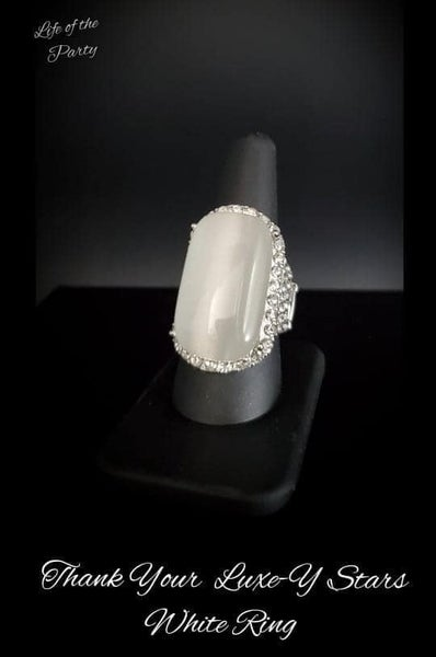 Paparazzi Thank Your LUXE-y Stars - White Moonstone/Cat's Eye stone surrounded by White Rhinestones Adjustable Ring - July 2021 Life of the Party Exclusive