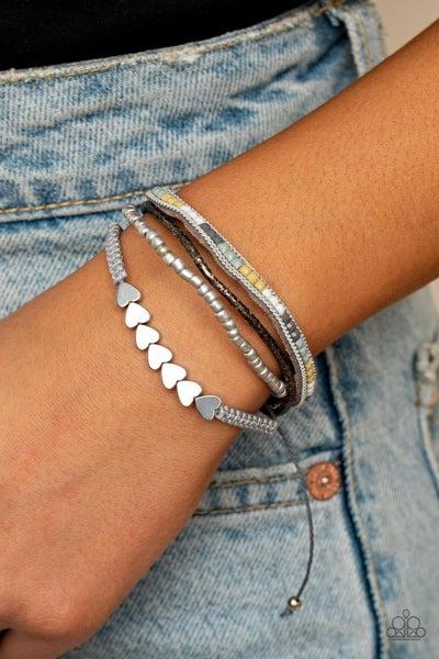 Pre-Sale - Paparazzi My Hearts Will Go On – Silver Hearts stung along multi-colored metallic cording Pull-Tight Bracelet