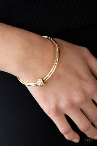 Roll Out The Rhinestones - Gold Bangles with a trio of White Rhinstone encrusted rings on Bangle Bracelets