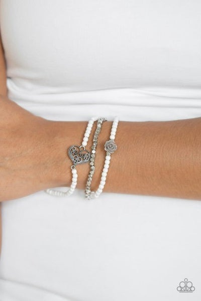 Lovers Loot - Three bands with White & Silver Beads with a Silver Heart & Flower Stretch Bracelet