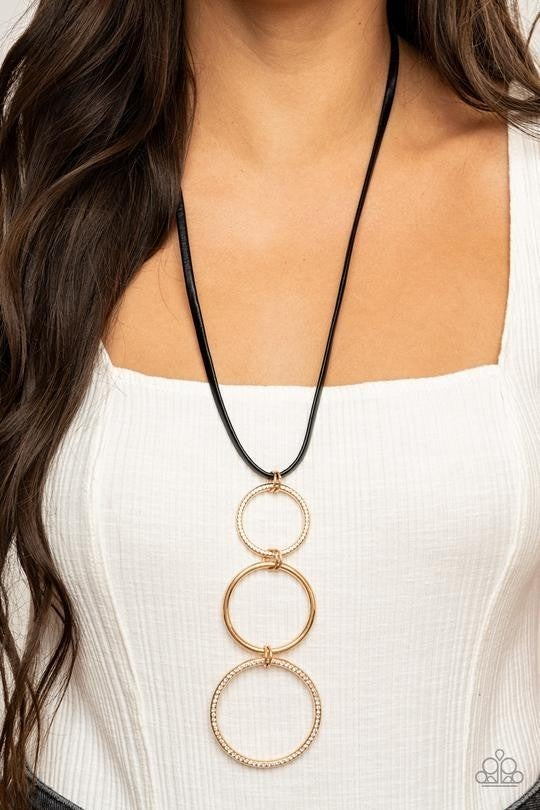 Curvy Couture - Gold interlocking Rings hang from a Black Leather Cord Necklace & Earrings