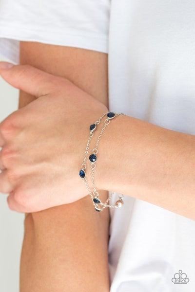Spotlight Starlight - Two strands of Silver with round Blue Rhinestones Bracelet
