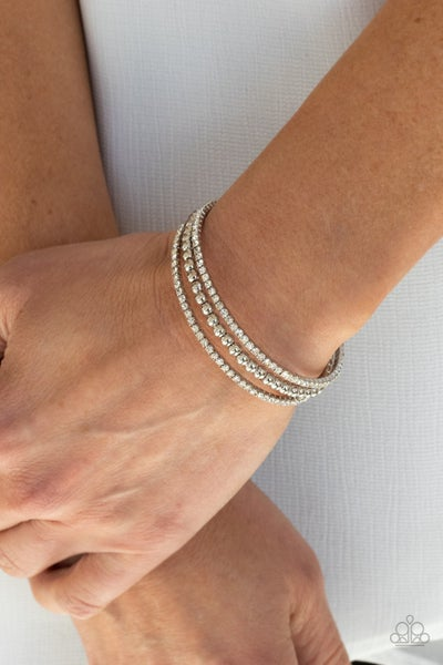 High-End Eye Candy - White Rhinstone strands with silver bead center strand Cuff Bracelet