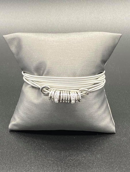 Magnetically Metro - 8 Silver strands with White Rhinestone encrusted Rings Magnetic Bracelet
