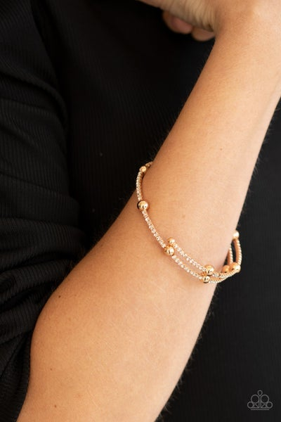 Standout Shine - Gold with white rhinestones coil Bracelet