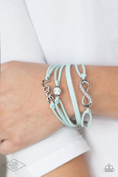 Infinitely Irresistible - Light Blue Suede knots holding Charms, an Infinity, a Rhinestone Solitaire & the word Love Bracelet