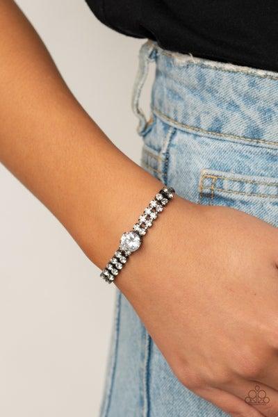 Paparazzi Gorgeously Glitzy – Gunmetal with White Rhinestones Pull-Tight Bracelet