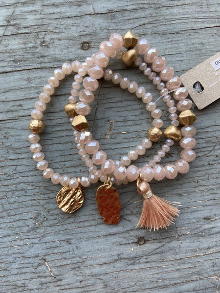 Pink beaded bracelet set w/ tassel and gold charms