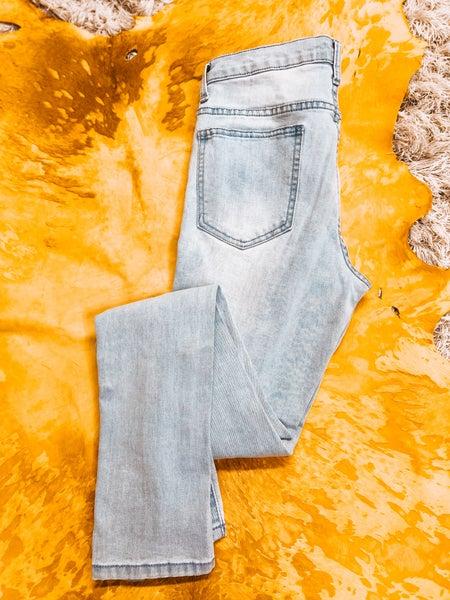 Ultra Distressed Skinny Jeans
