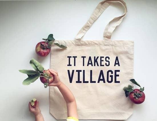 """It takes a Village"" Canvas Tote Bag"