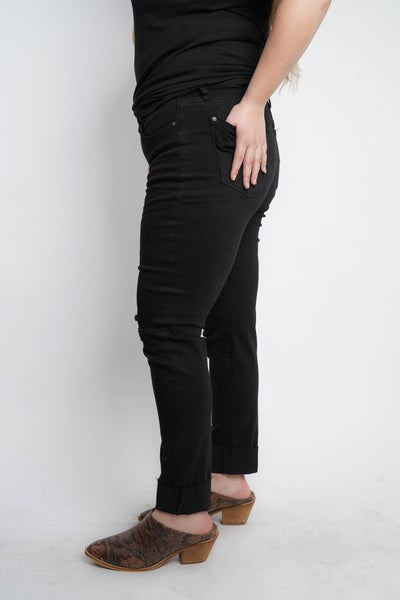 The SOPHIA Black Mid Rise Barely Distressed Slim Jeans By Judy Blue