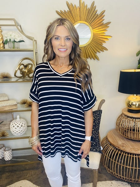 The Raven in black and white stripe tunic