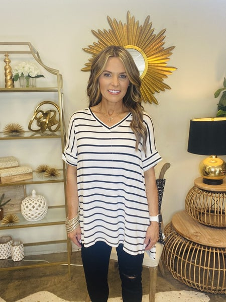The Raven in white and black stripe tunic