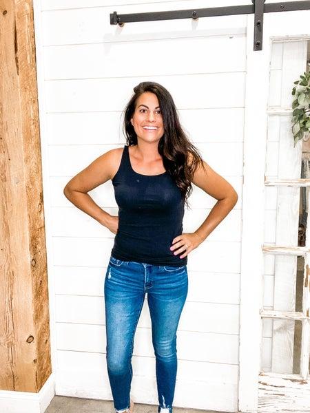 Distressed Hem Mid Rise Jeans