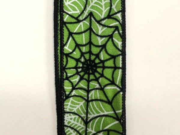 "lime satin/black flocked spiderwebs 1.5""x10yds"