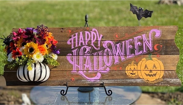 Happy Halloween sign with floral arrangement