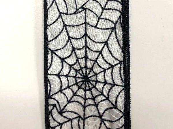 """white satin/black flocked spiderwebs 2.5""""x10yds"""